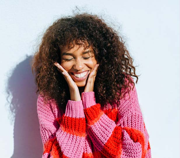 Girl with striped sweater blushing